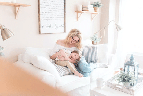 mother-and-small-child-cuddling-on-couch