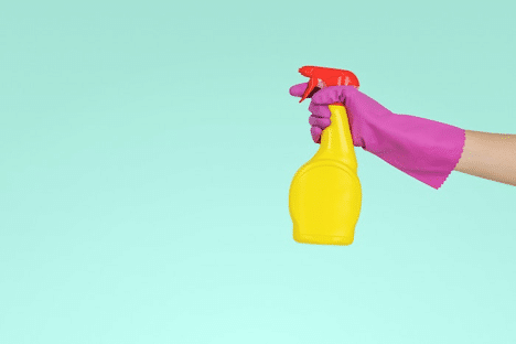 Maid-Service-spray-bottle-purple-gloved-hand