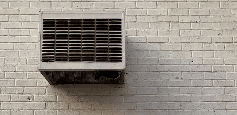 air-conditioner-on-white-brick-wall