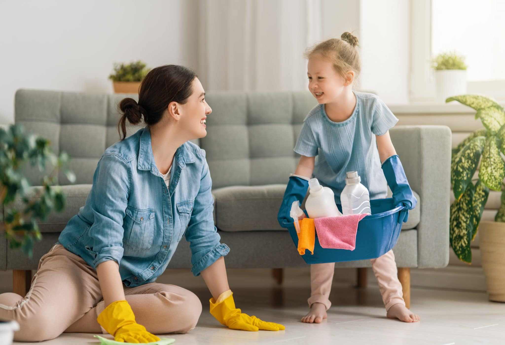 residential-cleaning-happy-mother-and-toddler-cleaning-together-using-safe-green-cleaning-products