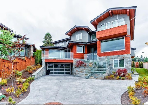 Exterior view gorgeous stone and stained wood house built into a hill - organize your home starts on the outside- American west